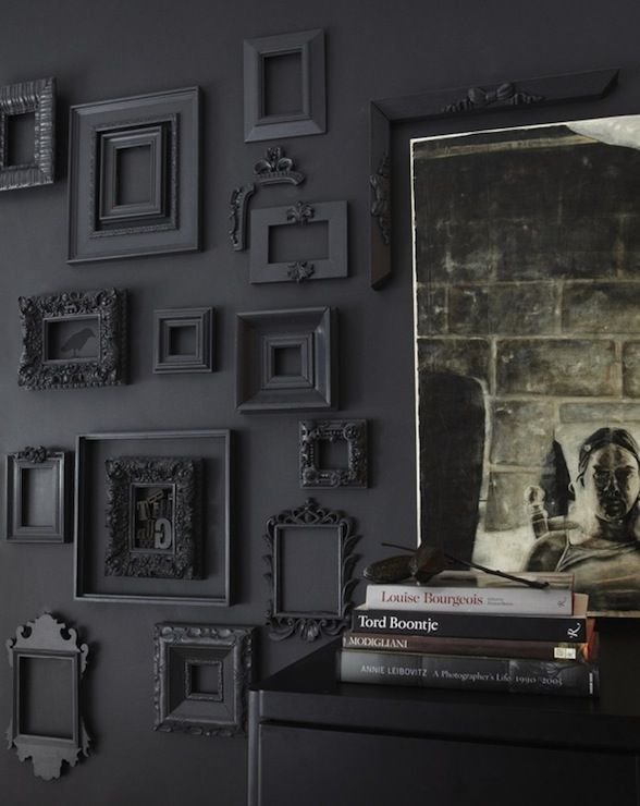 Janet Lee - Amazing black wall covered in collection of empty black frames.