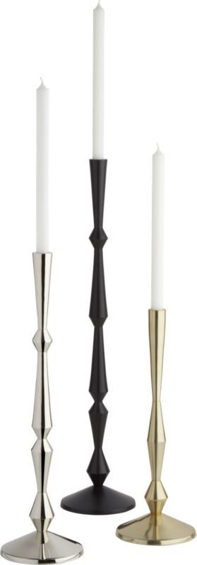 """<span class=""""copyHeader"""">glow stick.</span> Statuesque candlesticks take a modern turn in three sizes. Cut to create a series of interesting angles, sophisticated silhouettes give rise to a single taper holder. Arrange hi/lo with all three sizes and finishes, each with its own unique attitude. Candle sold separately.<br /><br /><NEWTAG/><ul><li>Aluminum with brass, nickel and black finishes</li><li>Holds one taper candle; sold separately</li><li>Wipe with soft, dry cloth</li><li>Made in…"""