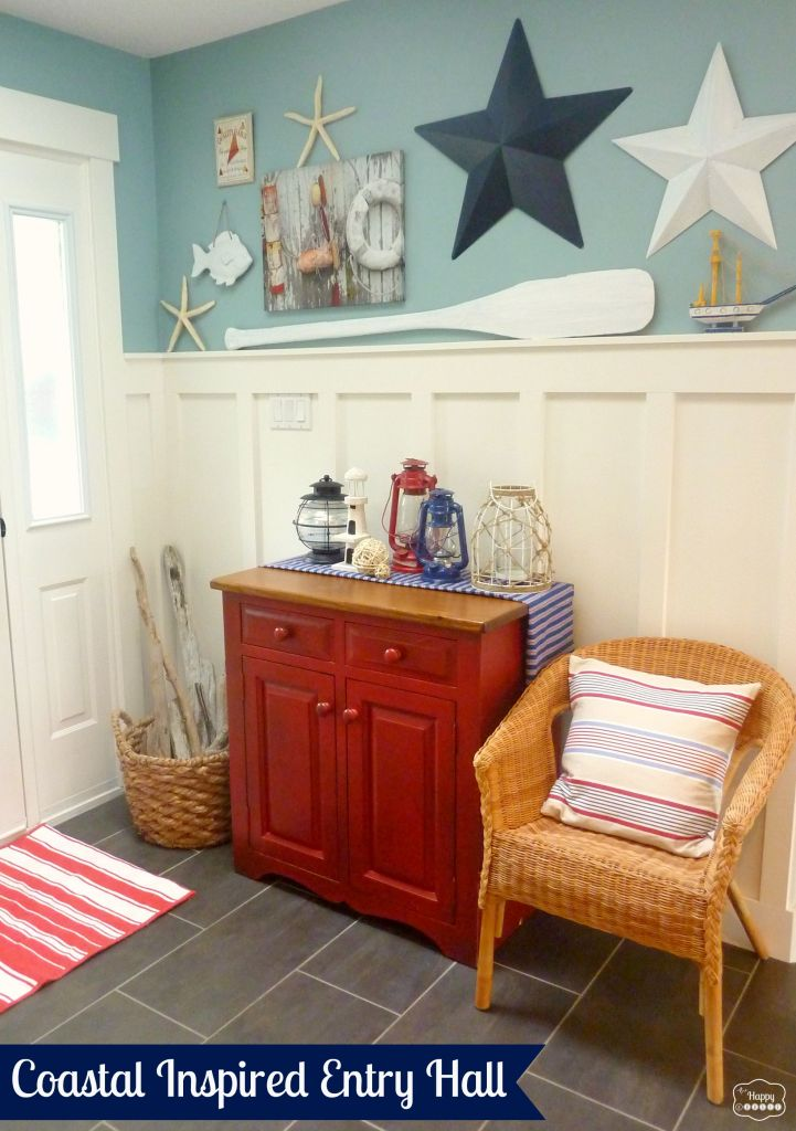Coastal Inspired Entry Hall with board and batten, gallery wall, lanterns, wicker chairs, red white and blue decorating, at thehappyhousie