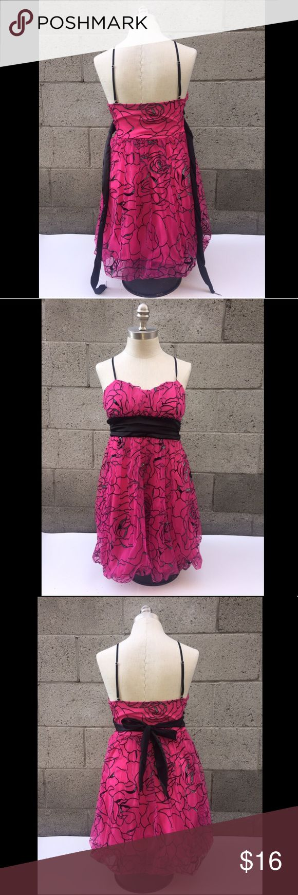 Pink and black rose pattern dress . Sparkly Pink Rose outline short dress.   The tag says it's is a Large but seems to run as a Small or Medium depending on your size  From top of dress (where chest begins) to bottom: 28.5 inches.   From top of dress to bottom (back side) 24 inches, since the back begins shorter.   Waist from one side to the other: 15 inches wide.  -No responsible for garments not fitting properly as we all have different body Dresses Midi