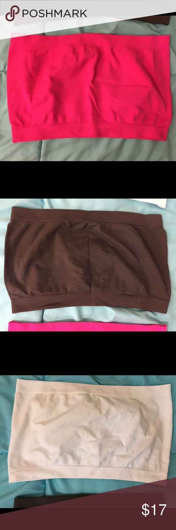 """3 Bandeaus (Pink, Charcoal Gray, White) Three bandeaus, one size fits most. I don't remember where they're from, so marked Forever 21 for exposure. Colors: pink, charcoal gray, white. $7 each or $17 for all three. Each only worn a couple of times, excellent used condition, but I cut most of the tags out because they were itchy. Bundle 2 or more items for 10% off, and feel free to make an offer! If you want to know my measurements, check my """"Meet Your Posher"""" listing! If you have any other…"""