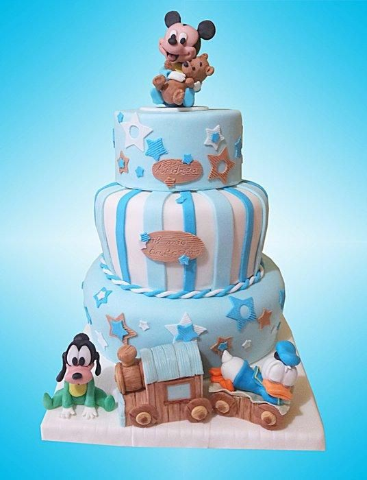 I made this cake for a baptism. Mickey Mouse & friends is all handmade and edible __