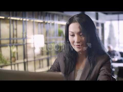 Smiling Businesswoman Working on Laptop (Stock Footage)