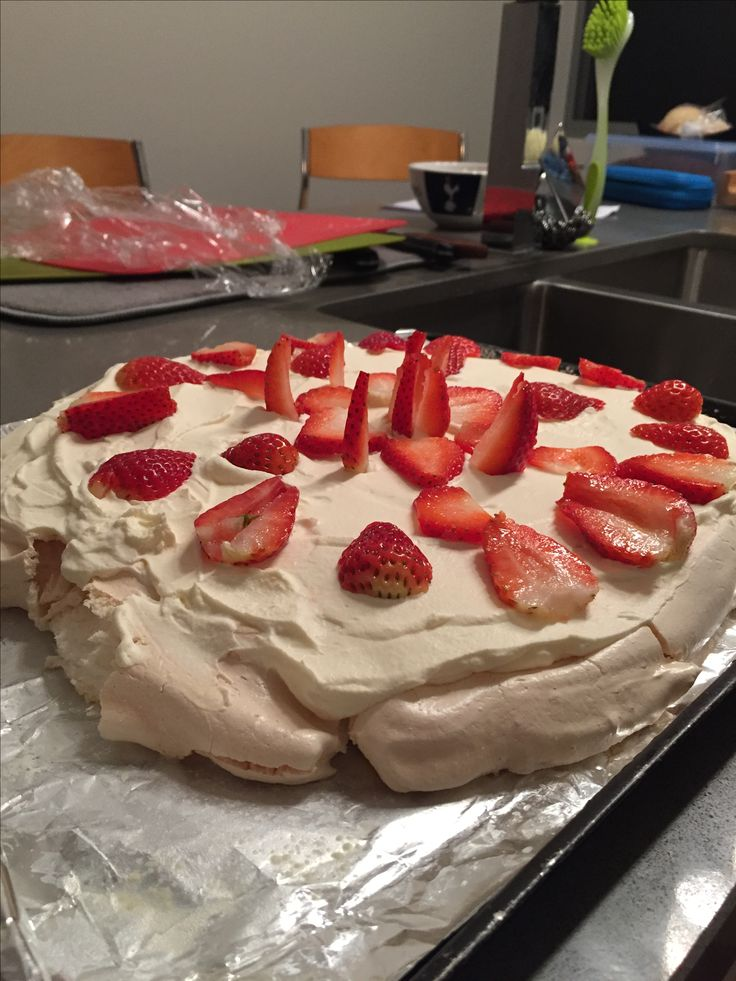 This  my first ever pavlova with fresh cream and strawberries #yum #strawberries #pavlova #cream