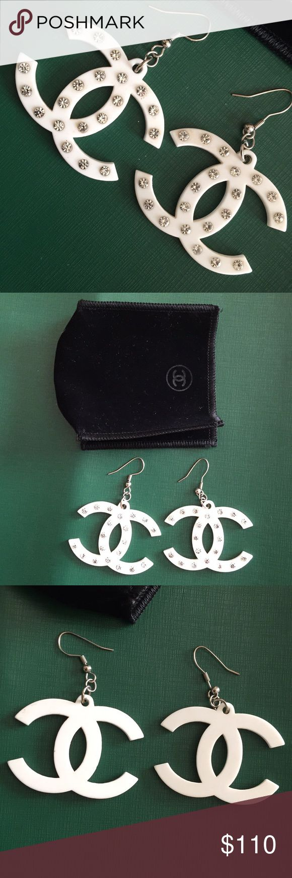Chanel logo earrings. Tenderly used. Swarovski crystals are intact and no discoloration. Comes with original pouch. Jewelry Earrings