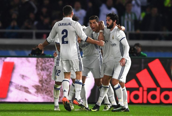 Cristiano Ronaldo of Real Madrid celebrates with team mates after scoring his sides third goal during the FIFA Club World Cup Final match between Real Madrid and Kashima Antlers