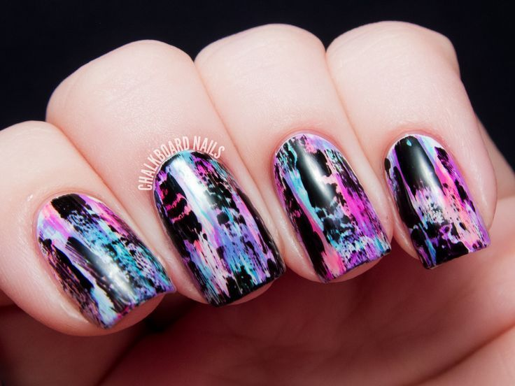 Distressed Nail Art (Punk/Grungy Effect) tutorial | From Chalkboard Nails, the nail art blog. Mixed media/shattered/crackle nail polish effect. Pink, blue, purple, and black colors. OPI Alphine Snow and American Apparel Hassid. China Glaze nail polish: Rose Among Thorns, Too Yacht to Handle, That's Shore Bright.