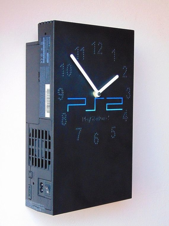 It looks better as a wall clock than a video game! :)  Upcycled wall and desk, table clock from the well known retro PS2 Fat, Sony PlayStation 2, PlayStation2 video game console not only for men or gamer fanatics - childhood is closed in time :)  I creatively recycled this clock from a faulty, second series Sony PlayStation fat console – which was the most popular game of the world – to never forget your childhood! This PlayStation version is bigger than the gray and white PS1 consoles, its…
