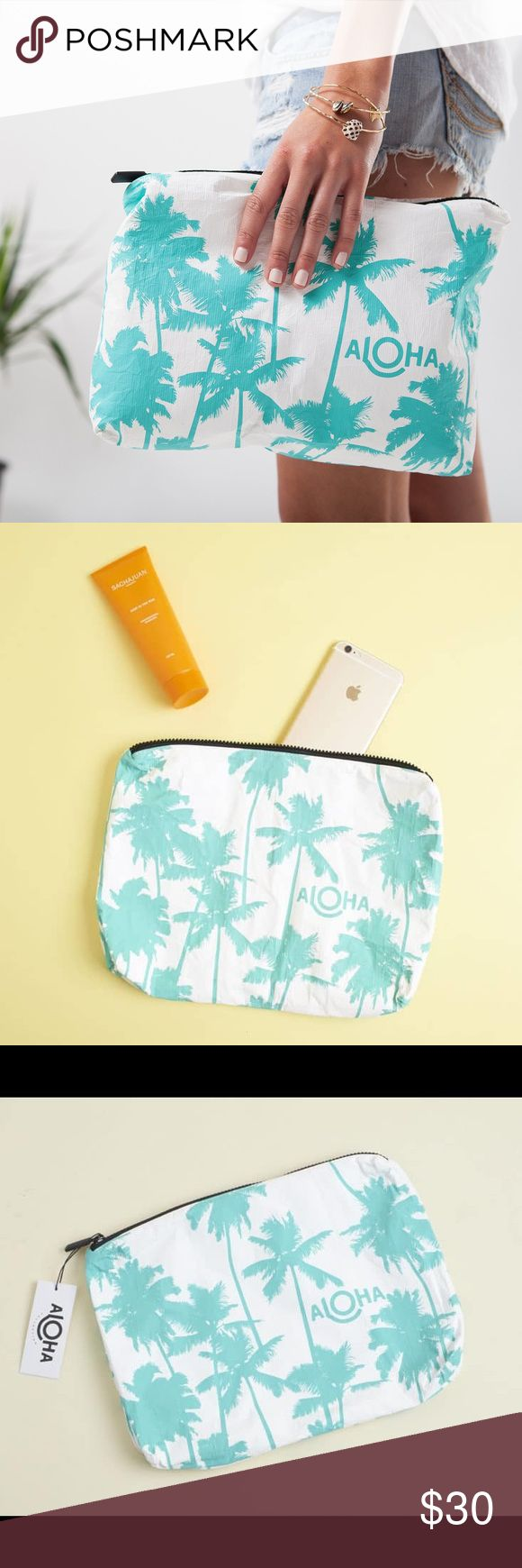 "Aloha Wet/Dry Bag  Brand new in packaging. Super cute! I live in sunny Seattle. I know someone else would be able to enjoy this gem more than I will. From Popsugar box June 2017. Take a little Kauai with you on your next adventure! This print was inspired by Kauai's coco palms and the famous Coco Palms Resort.   This pouch is perfect to use as a beach clutch.  Stow your sunscreen, sarong, and bikini, or pack toiletries for your next trip!  Mid-size pouch measures:  11.5"" across x 2"" wide x…"