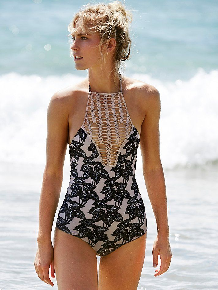 Teaehupo'o Full Piece Print   Printed high neck one piece swimsuit pieced with crochet detailing.  Adjustable halter tie with tassel ends.  Lined.