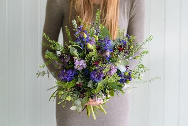 A sultry collection of the deepest blues and purples, with a pop of burgundy, tied with vibrant mixed foliage.