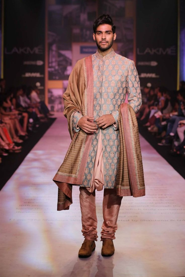 Shantanu and Nikhil's colorful rustic men's sherwani #indianfashion #groom