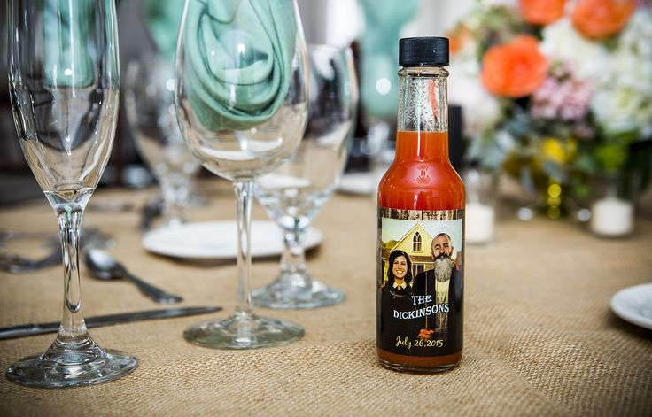 My husband is a chef and I am in the art & design field, so what better way to give our guests something that represents the both of us? My husband made the hot sauce himself and I made our label. I photoshopped our heads in the American Gothic painting, then gave my husband a beard from Si (Duck Dynasty). We personally bottled the hot sauce and placed the labels on by ourselves too. #teamwork #wedding #partyfavors #hotsauce #diy