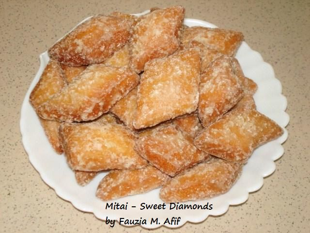 These addictive little sweet diamonds are some of the most delicious snacks from the Coast of Kenya. They're probably known all across East Africa too. Fantastic to have with your evening cup of tea or coffee and they work beautifully as a sweet breakfast dish too! It is reminiscent of mandazis, just that these have the sugar coated on the outside of the mitais instead of having it inside the dough. The recipe is a combination of several different recipes, with my own adjustments to make ...