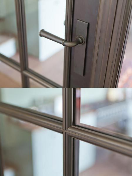 close up of bronze door handle and glazing bars.