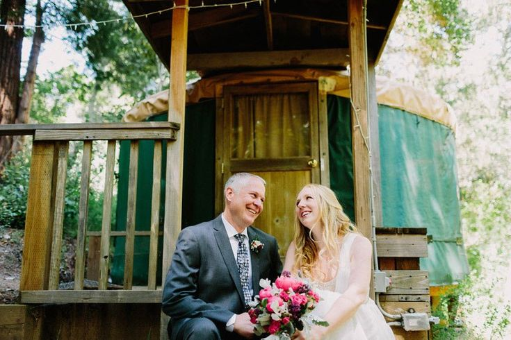 A rustic music festival wedding in the towering redwoods