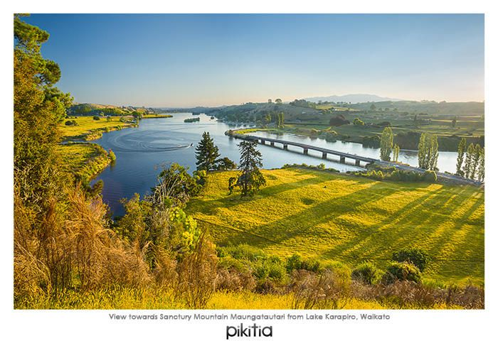 Postcard 'View towards Sanctuary Mountain Maungatautari from Lake Karapiro, Waikato' which is found in Pikitia's high quality range of postcards