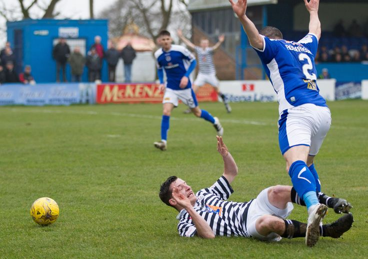 Queen's Park's David Galt is brought down during the Ladbrokes League One game between Stranraer and Queen's Park.