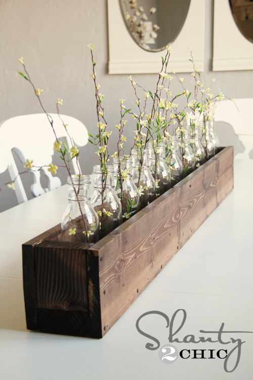 Love this! Glass bottle bud vases in a DIY planter box. There's a link on her blog to a really awesome site that sells specialty glass bottles and jars FOR CHEAP!