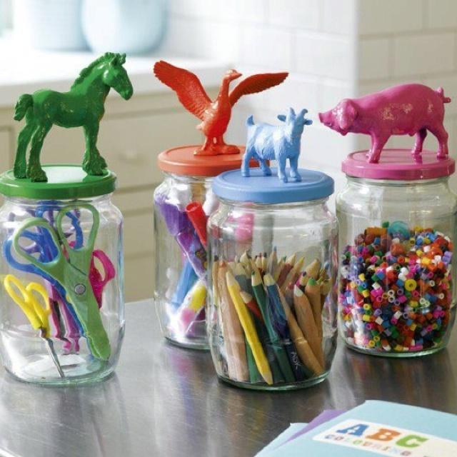hot glue figurines on jars. Spray paint lids and animals. so cute!