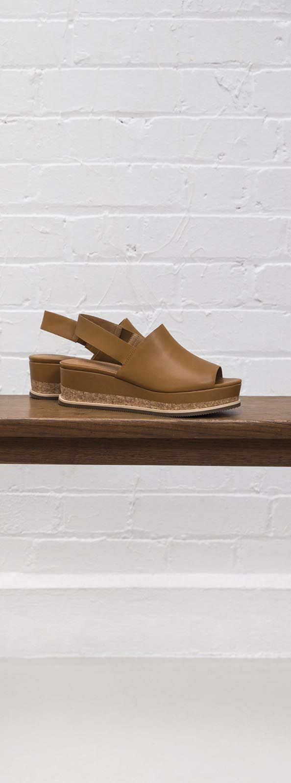 Take your summer footwear to new heights with the Cork Detail High Wedge Sandals.