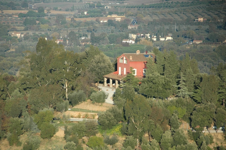 Flying over Relais Vedetta: a red spot on the green of the nature