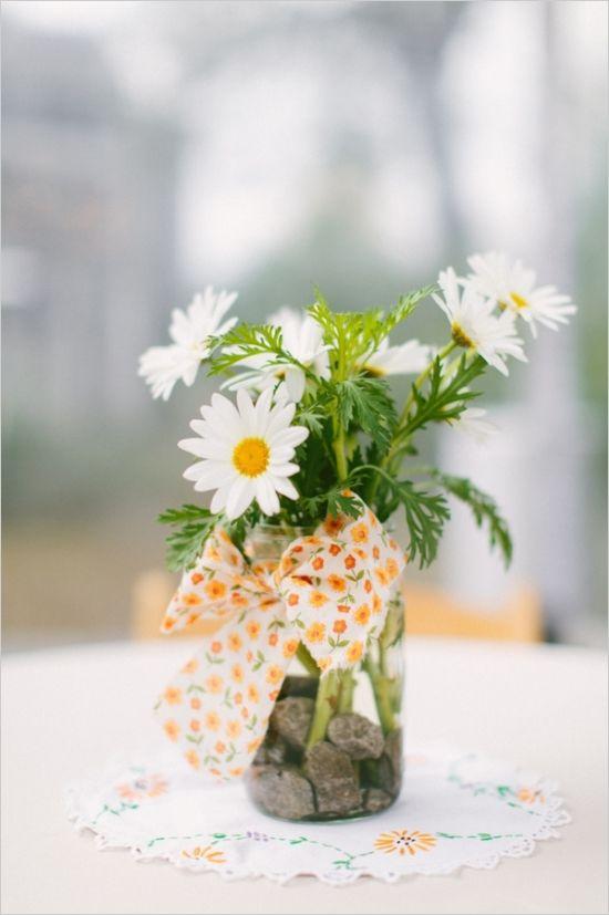 simple daisy and mason jar centerpiece #weddingflorals #daisy #weddingchicks http://www.weddingchicks.com/2014/03/10/unique-and-earthy-wedding/