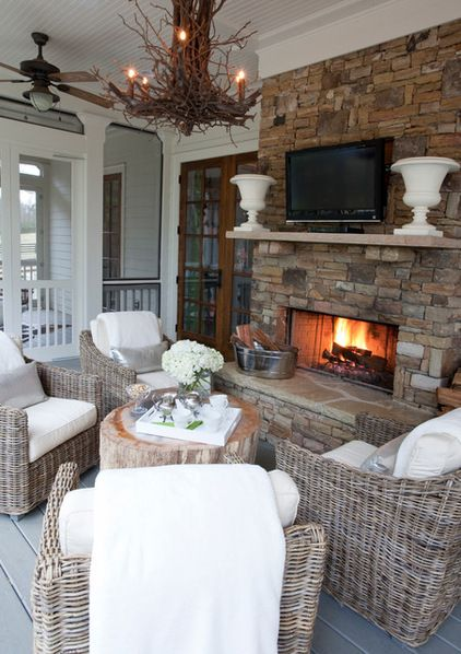Love this outdoor fireplace/ media center. Bring on Game Day!  | Transitional Porch by Lindsey Hene Interiors