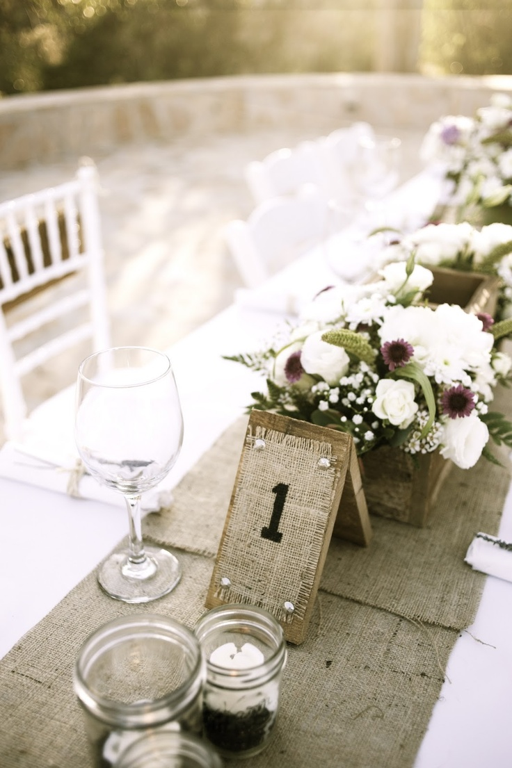 Table numbers and flower boxes.  Love the burlap and white combo.