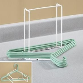 Hanger Storage Rack $7. avail at The Container Store, love it.