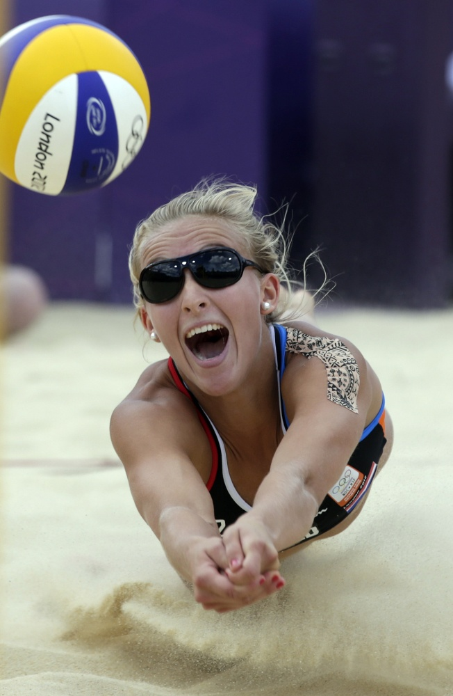 Sophie Van Gestel of the Netherlands digs out a ball during a beach volleyball match against Brazil at the 2012 Summer Olympics, Friday, Aug. 3, 2012, in London.