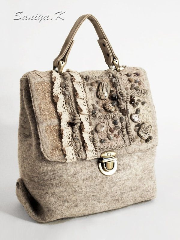 """Handbag felted """"Rustic Style"""" by SaniyaK on Etsy  The felted handbag """"Rustic Style"""" is made from natural merino wool. Valve of bag is embroidered linen lace, beads of jasper, agate and moonstone. Knob - leather. Inside handbag lining with pockets: to """"lightning"""", open and for phone. The bottom of additionally sealed, metal legs.  https://www.etsy.com/ru/listing/503529137/handbag-felted-rustic-style"""