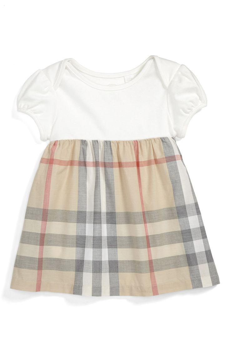 Such a cute little Burberry dress.