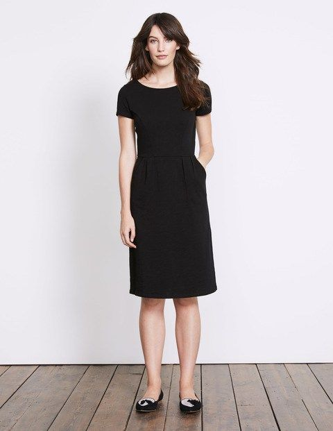 Phoebe Jersey Dress with pockets in black from Boden. The ideal dress for office work, or smart-casual occasions. Find it at www.pocketsrock.com. The Pockets Rock site contains affiliate links. If you make a purchase after following a link from the site, Pockets Rock may receive a small commission.