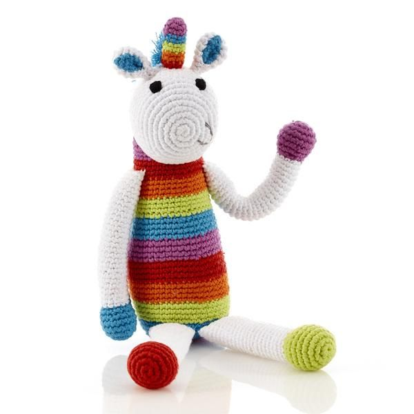Unicorn rattles are very useful if your own magic runs out. This one is also good for cuddles and playtime. This crocheted toy was handmade by women in Banglade