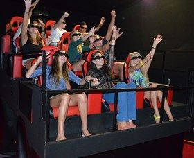 7D Cinema - Virtual Reality: 7D Cinema brought the newest technology in Virtual Reality to Australia! You are buckled up in Ferrari-style seats in a nine seat simulator platform. The entire platform moves according to what is happening on screen whilst you are watching a...