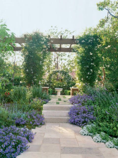In the home's outdoor garden, sweet alyssum, blue salvia and potato vine grow abundantly.