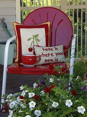 love these old chairs...doing my back yard in Texas reds and lone stars. Love the iron look. I chose a red and white floral for pillows and cushions. Thinking I might have to utilize some denim for a rustic look for throw pillows.