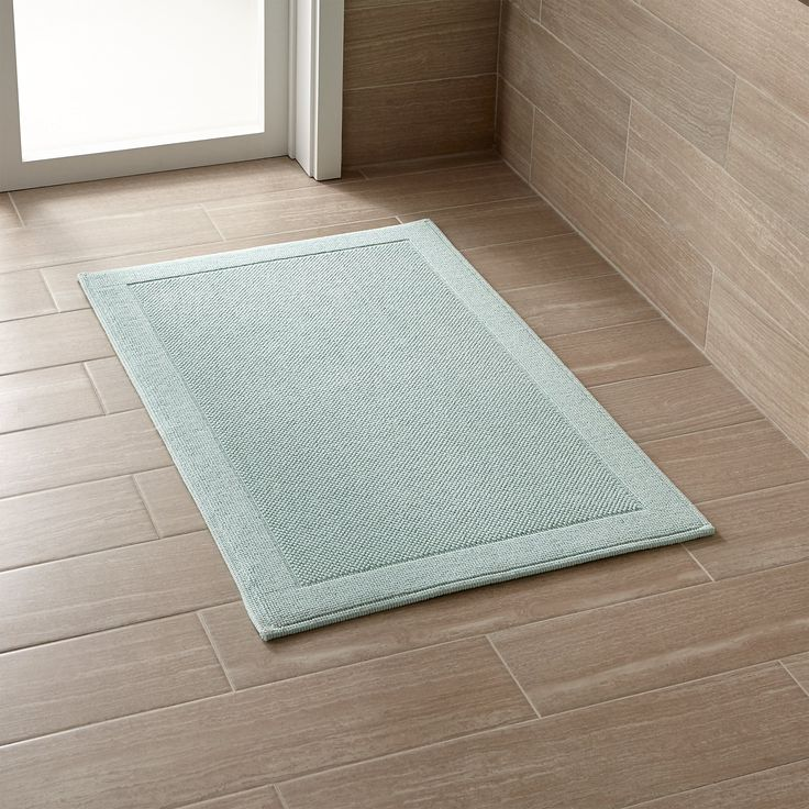 Shop Westport Teal Bath Rug.  Subtly textured Teal bath mat works in any décor, absorbing wetness and drying quickly. This product is certified by Oeko-Tex®, an international association focused on textile safety and sustainable production.