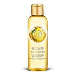 Sweet Lemon Beautifying Oil - Beautifying Oil is pure beauty in a bottle. Made with a lightweight blend of nut oils including Community Fair Trade marula oil, it gives instant hydration and a shimmering finish. This one smells of fresh lemon. $14Thebodyshop, Beautiful, Bath, Beautify Oil, Hair, Fair Trade, Products, Community Fair, The Body Shops