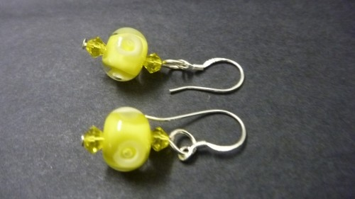 ChrysalisArtGlass: This is a custom order.  Lampwork glass bead earrings shown in the first 2 images in a lovely sunny lemon yellow. Tiny bubbles are encased within the glass. Also available in a wide range of colours, please check out my other listings to see some of the range of colours.  These are lovely gifts for bridesmaids and can be made in colours to match the dresses.  Please contact me regarding your colour preference and I will email you the images for your approval before…