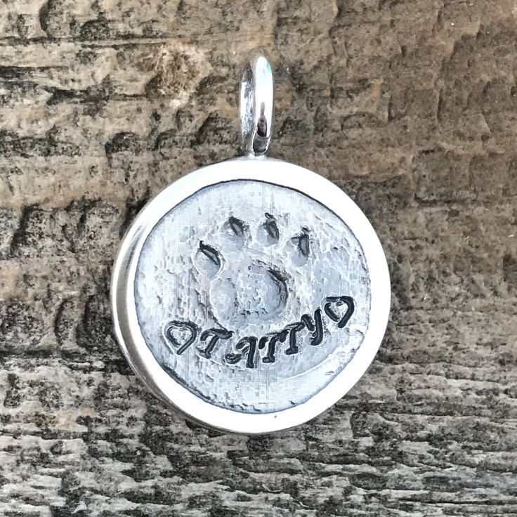 Pet Paw Cast turned into a silver charm. Create jewelry from a photo of a pet paw cast.