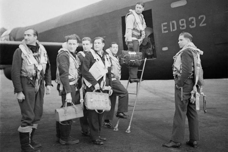 The World War II 617 Squadron Dambusters with a Lancaster bomber aircraft at Royal Air Force Scampton, 16 May 1943.