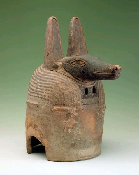 Ceramic Anubis mask, one of the only surviving helmet masks from Egypt, it weighs about 17lbs and dates from ca.600BCE. The two holes below the head are eye-holes for the priest who wore it | Hildesheim Pelizaeus-Museum