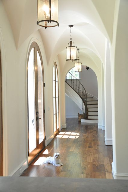 Cathedral style hallway.  Arched French doors
