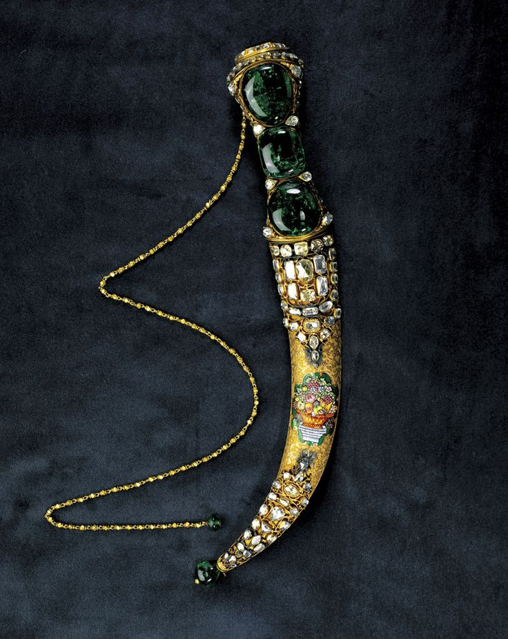 Topkapi Emerald Dagger. Treasury, Topkapi Palace Museum, Turkey. Dagger is set with three large Colombian emeralds. Its a long dagger at 35 centimeters, given as a gift from the Shah Nadir to the Sultan Mahmud I of Turkey. Another large emerald covers a watch hidden in the base. The emeralds are surrounded by diamonds and gold.