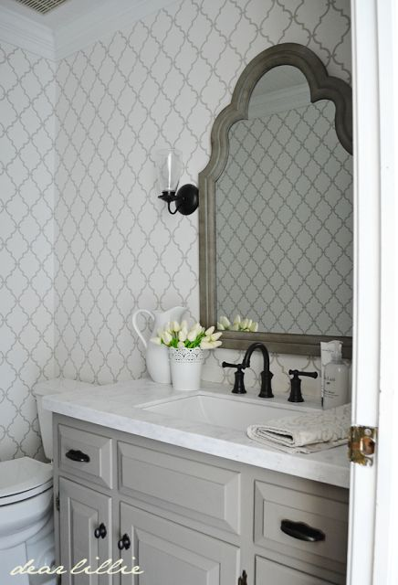 Love the bathroom wallpaper and mirror