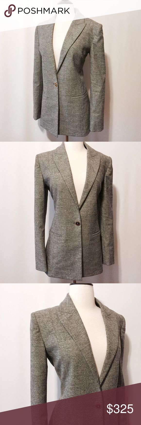 """🌀 Balenciaga Classic Tweed One Button Blazer Designer Dream!! Classic black and white wool tweed, long one button closure with peak lapel, Princess seams for great fit with functional welt pockets, kick pleat at center back. Fully lined.  Whether you specialize in designer clothing in your closet or you're just starting out this piece is a must have!! Add this jacket to any outfit and BAM!!   98% Wool 2% Elastane  100% Rayon lining  Dry Clean Only  Made in France  39"""" bust  36"""" waist  16…"""
