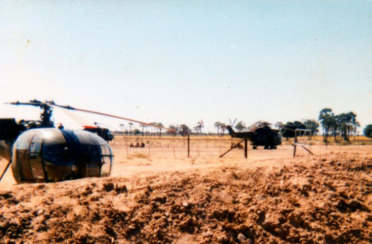 Ombaluntu, May 1980. Alouette and Puma just outside north of the camp.