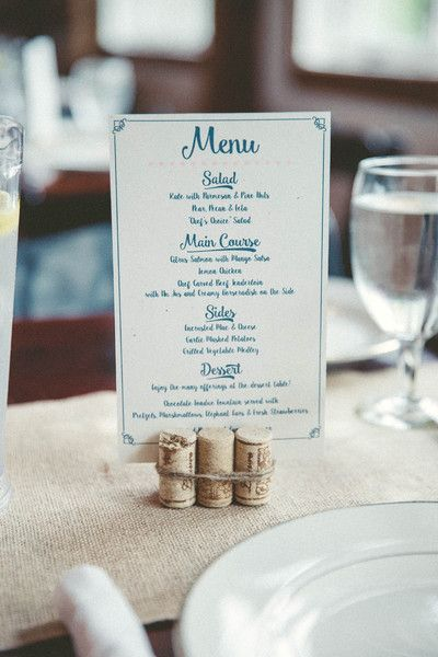 Blue and white wedding menu cards displayed with wine cork stand {Lightbloom Photography}